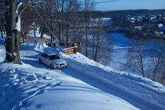 White car driving on snowy road Royalty Free Stock Photo