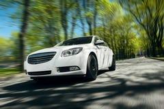 White car fast drive on asphalt road royalty free stock image