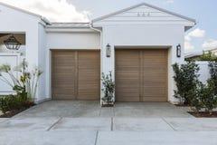 White 2 car garage doors Stock Photography