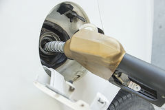 White car at gas station Royalty Free Stock Photo