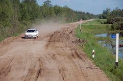 White car at gravel road Kolyma highway at Yakutia Royalty Free Stock Photos