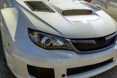 White car hood with vent for airflow front headlights Stock Photography