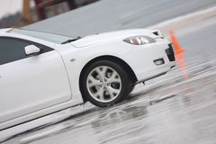 White car on ice. Moving white car on ice Royalty Free Stock Photo