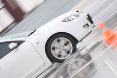 White car on ice. Moving White car on ise Royalty Free Stock Images