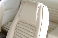 White car interior. White drivers seat and interior from a vintage 1969 sports car Royalty Free Stock Image
