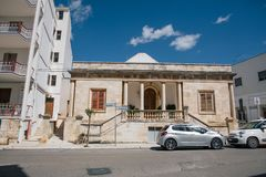 White car in Trullo trulli city streets in Italy stock images