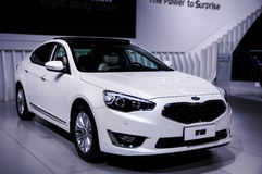 A white car of Kia. Take on the 16th Chongqing International Motor Show, June 6th-12th, 2014. There are many international famous brand companies and Stock Images