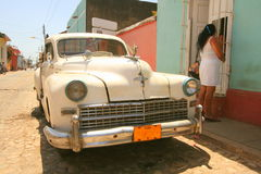 White car and lady in white dress Royalty Free Stock Photo