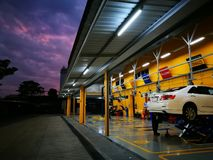 White car  in maintenance in garage service station stock photography
