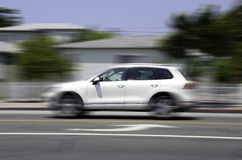 White car in motion on road Stock Photo