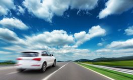 White car moving on highway. Added motion effect stock photography