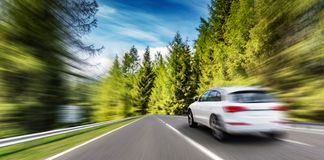 White car moving on highway. Added motion effect royalty free stock images