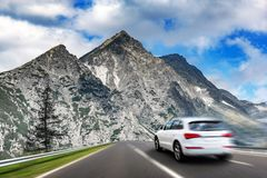 White car moving on highway. Added motion effect stock image