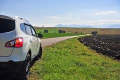White car moving by the rural road. Slovakia royalty free stock images