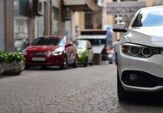 Parked cars on narrow street Royalty Free Stock Photos