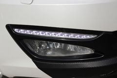 White car part, car headlight. led white daily lights. stock photography