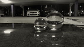 White car reflection puddle carpark at night rainy day balls. Full relection of white modified hatch in carpark at night using props crystal balls Stock Images