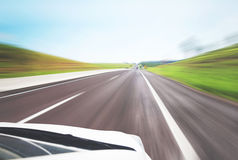 White car running very fast on highway. Blurred motion Stock Photos