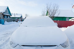 White car in the snow Royalty Free Stock Image