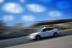 White car speeding with motion blur Stock Photography