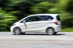 White car Speeding in road. Asia Stock Image