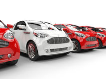 White Car Stands Out in a Row of Red Cars Stock Photos