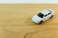 White car toy on wood table image close up. The white car toy on wood table image close up stock photos