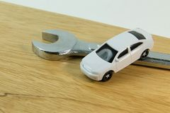 White car toy on wood table image close up. The white car toy on wood table image close up royalty free stock photography
