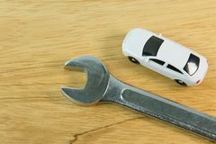 White car toy on wood table image close up. stock photo