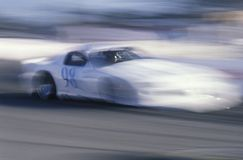 A white car in the Toyota Grand Prix Race at the Indy Car World Series in Long Beach, CA Stock Images
