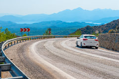 White car in turn a   road. White car in turn a mountain road Royalty Free Stock Photography