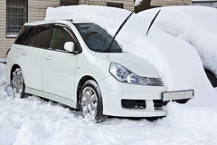 White car is under the snow Stock Photo