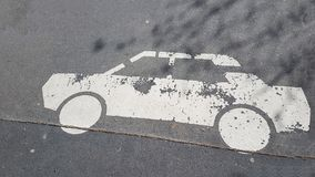 White Car Vehicle Picture Sign Printed in Asphalt Wallpaper Backgroung Texture Pattern. White Car Vehicle Picture Sign Printed in Asphalt Wallpaper Backgroung stock photography