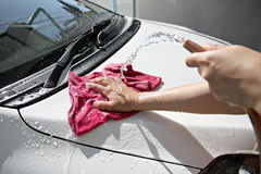 White car washing with fabric and Water hose. Stock Photos