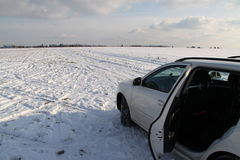 White car on the white field Royalty Free Stock Photos