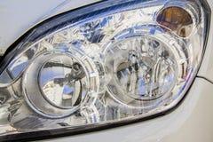 White car xenon headlight Stock Photo