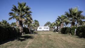 White caravan in a camping Stock Photography