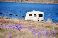 White caravan on a lake background Royalty Free Stock Image