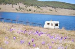 White caravan on a lake background Royalty Free Stock Photo