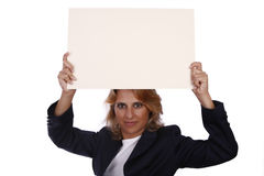 White card. Woman with a positive attitude holding an empty white card Royalty Free Stock Photos