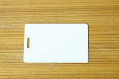 White card. On the wood table in the room Royalty Free Stock Photography