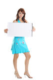 White card. The beautiful girl holds the form for advertising Royalty Free Stock Image