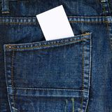White card in a back pocket of a jeans Royalty Free Stock Images