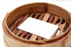 White card in chinese bamboo steamer Stock Images