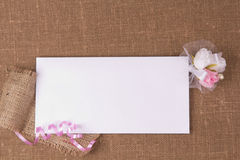 White card for congratulation. On a background on coarse fabric Stock Photo