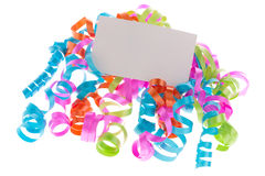 White card on curly ribbons Stock Image