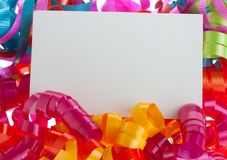 White card on curly ribbons Stock Photo