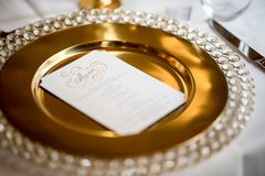 White Card on Gold Plate stock image