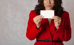A white card in the hands of a young woman. Stock Photo