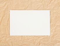 White card on packing paper Royalty Free Stock Photos